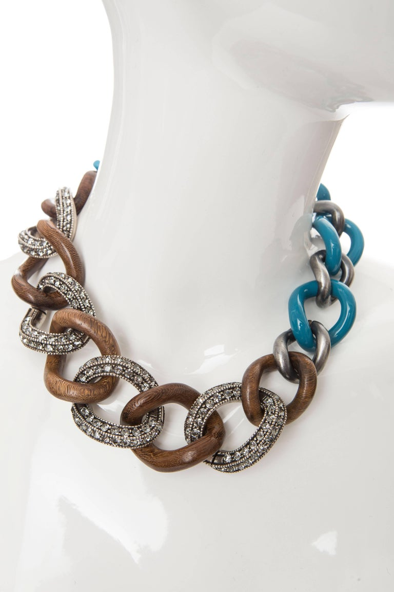 Gunmetal, wood and blue enamel Lanvin chain-link necklace with crystal embellishments and toggle closure. Chain Length 11