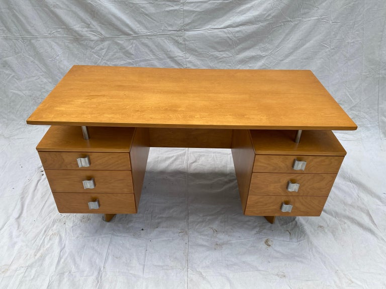 Eliel Saarinen for Johnson Furniture company birch desk, beautifully refinished in it's original color. Saarinen designed a complete series for the company. This being the absolute show stopper! Curved base matches the curved handles. Floating top