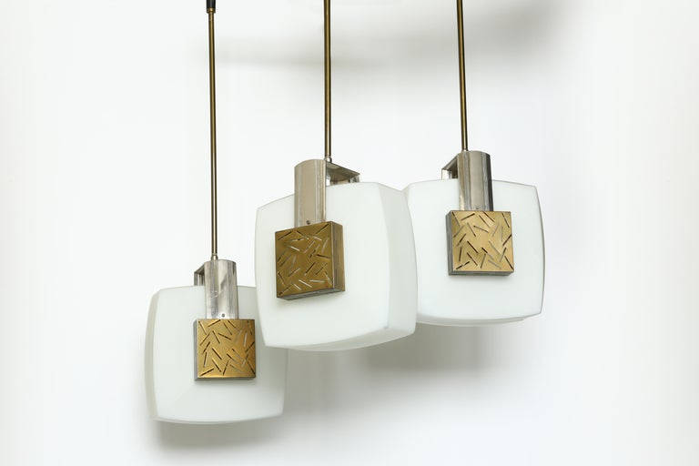 Elio Monesi for Arredoluce ceiling pendant. Model 12815. Glass, patinated brass, nickel-plated metal.