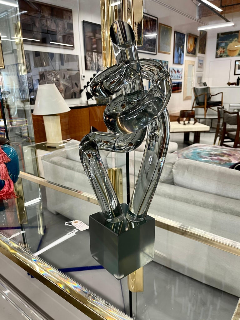 A wonderful smoked glass twisted sculpture by the Italian Master Elio Raffaeli. Approximately 21 inches tall. In good age appropriate condition, with some minor marks on the base.