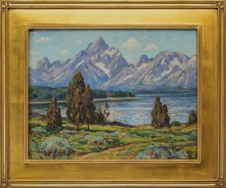 An original oil painting by Eliot Clark (1883-1980), a mountain landscape of Jackson Lake and the Grand Tetons in Wyoming.  Presented in a custom frame, outer dimensions measure 19 ½ x 23 ½ x 1 ¼ inches.  Image size is 14 x 18 inches.  Eliot Clark