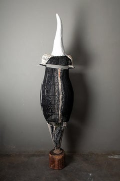 The dress of power 1, Elisia Nghidishange, mixed media, plaster, fabric, wood