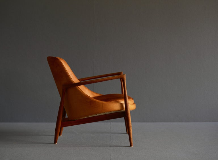"""""""Elizabeth"""" chair by Ib Kofod-Larsen by Christensen & Larsen Cabinetmakers. It is in oak with the seat and back upholstered in patinated natural leather. It is circa 1960. The original stamping remains.  These chairs were initially known as the"""