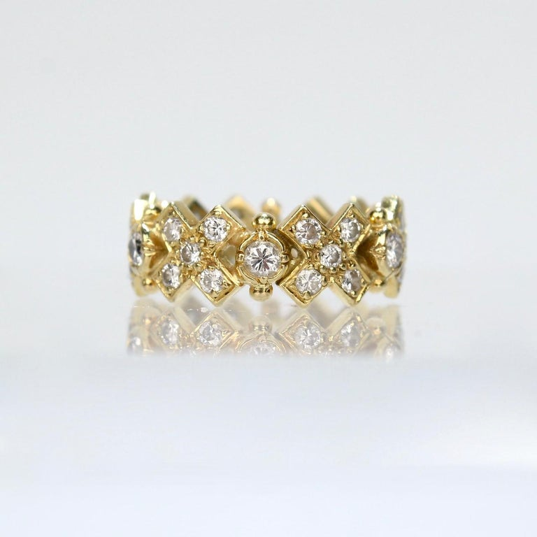 An Elizabeth Gage Hugs and Kisses ring.  In 18k yellow gold and set with 36 round brilliant cut diamonds.   A wonderful ring from one of the world's premier jewelry maker!  Ring size: ca. 6 1/2 Diamond Approx TCW: just under 2 ct. by