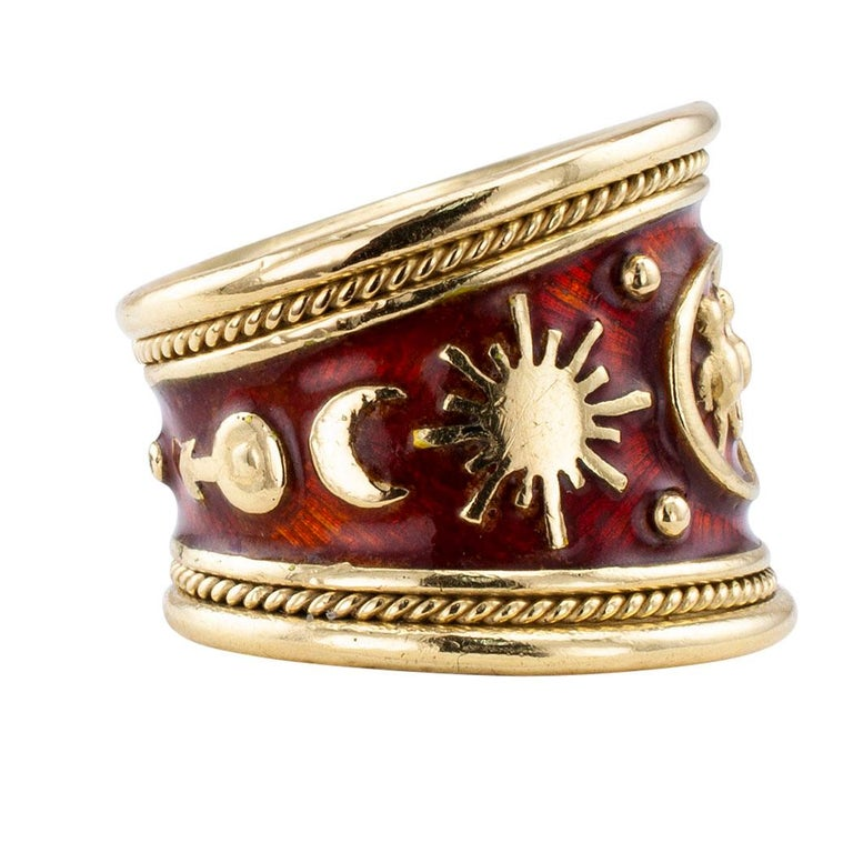 Elizabeth Gage enamel and gold Gemini cigar band ring circa 2000. The astrologically inspired design is entirely decorated by symbols for Gemini and a host of other astrologically appropriate symbology, all in relief, on a base of reddish-chestnut