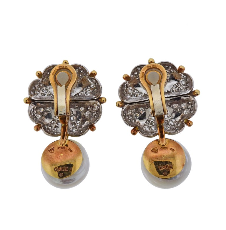 A pair of 18k yellow gold earrings by Elizabeth Gage, set with approx. 2.20ctw in G/VS diamonds and 15.8mm pearls.  Earrings are 42mm x 25mm and weigh 38.8 grams. Marked Gage, EG, 750, English gold assay marks.