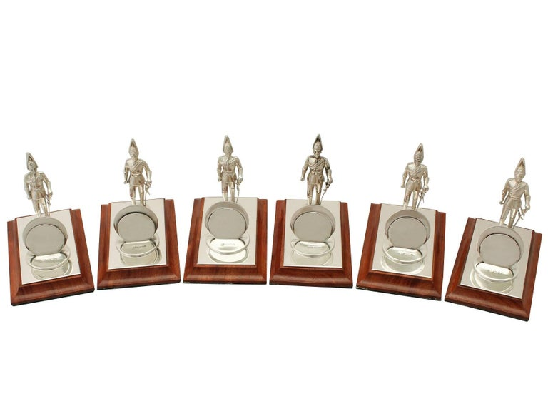 An exceptional, fine and impressive set of six vintage Elizabeth II English sterling silver and wood menu holders with military interest; an addition to our dining silverware collection.
