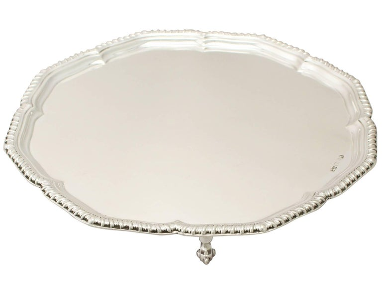A fine and impressive vintage Elizabeth II English sterling silver salver; an addition to our silver dining collection.