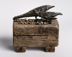 Sculpture of black birds and body parts: 'When the grackles too over'