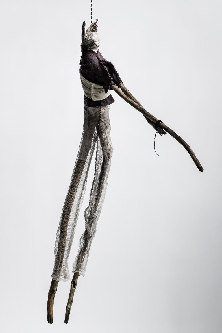Elizabeth Jordan Figurative Sculpture - Sculpture of hare hanging form chain: 'Children 5'