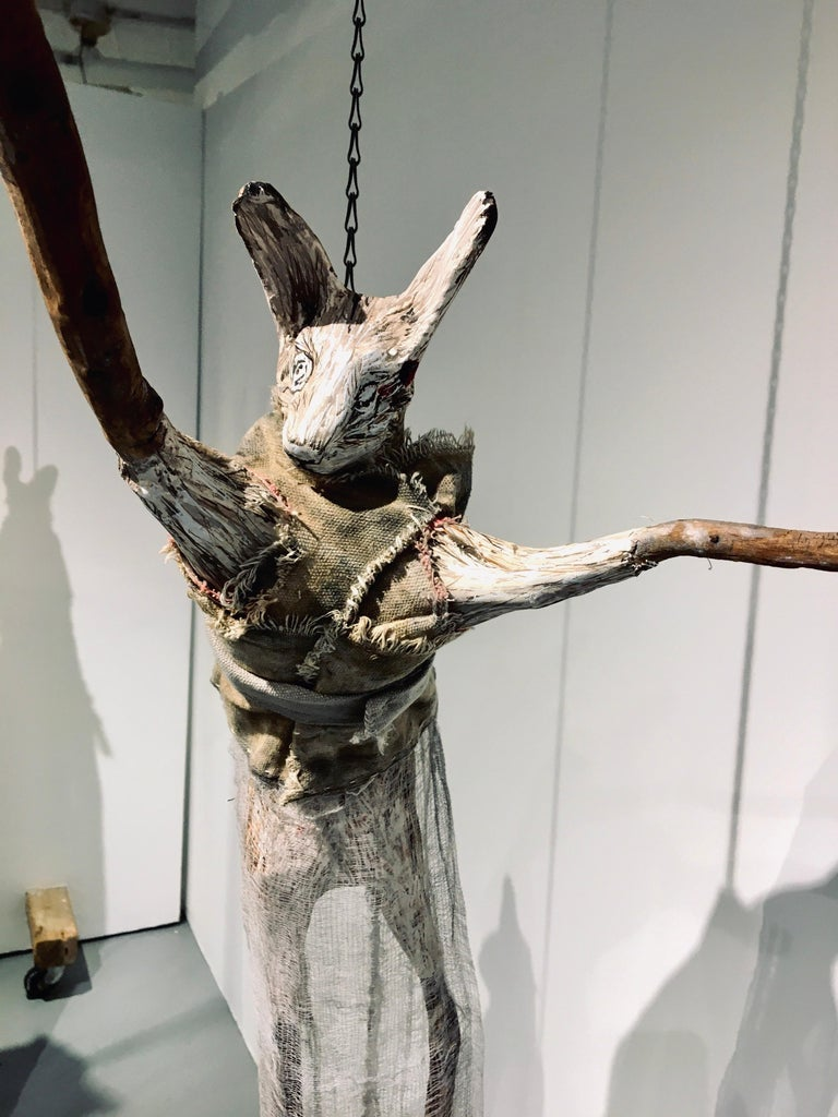 Sculpture of hare hanging from chain: 'Children 7' - Brown Figurative Sculpture by Elizabeth Jordan