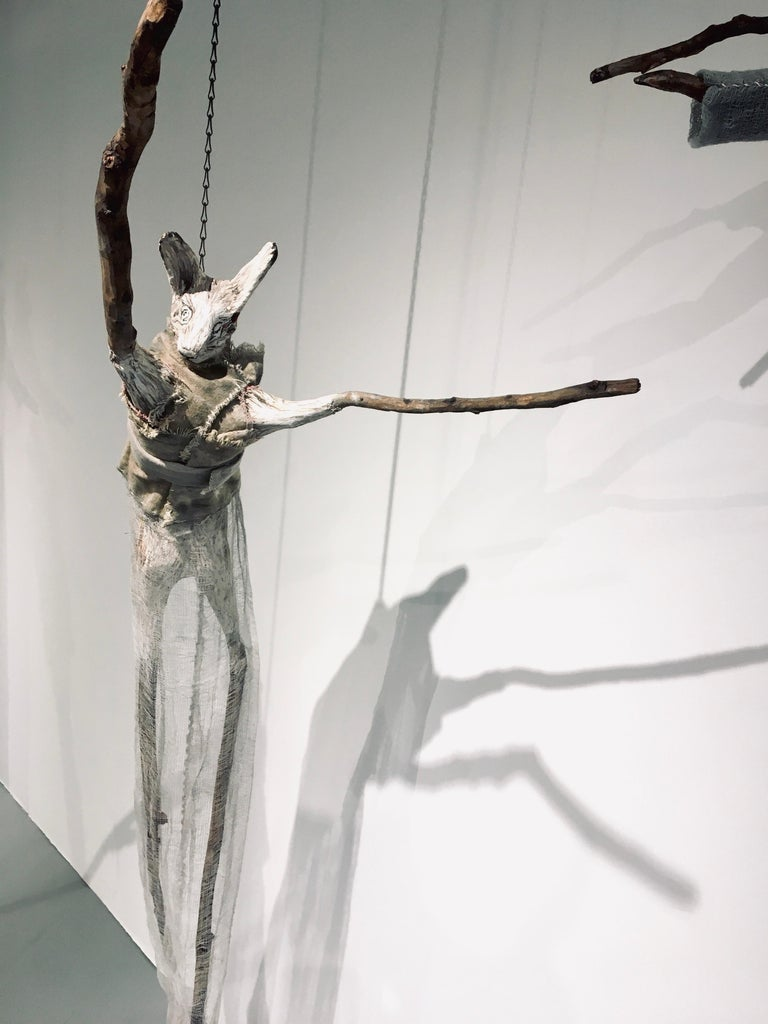 Elizabeth Jordan Figurative Sculpture - Sculpture of hare hanging from chain: 'Children 7'