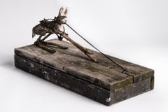 Sculpture of hare on wood base with mask on: 'Children 11'