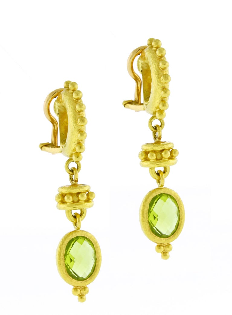 From Elizabeth Locke, her curved hoop earrings with large granulation and oval peridot drops. ♦ Designer: Elizabeth Locke ♦ Metal: 19 karat ♦ Gem stone: Peridot 9 X 7 mm  ♦ Circa 2010 ♦ Size  1 5/8 inches ♦ Packaging: Pampillonia presentation box  ♦