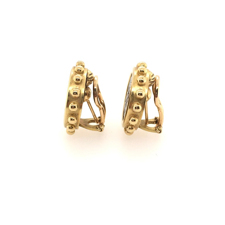 A pair of 18 karat yellow gold and ancient silver coin earrings, Elizabeth Locke, Circa 1990s.  The coins are bezel set in a circular gold mount with applied gold bead frame.  The earrings have a gross weight of approximately 24.6 grams and measure