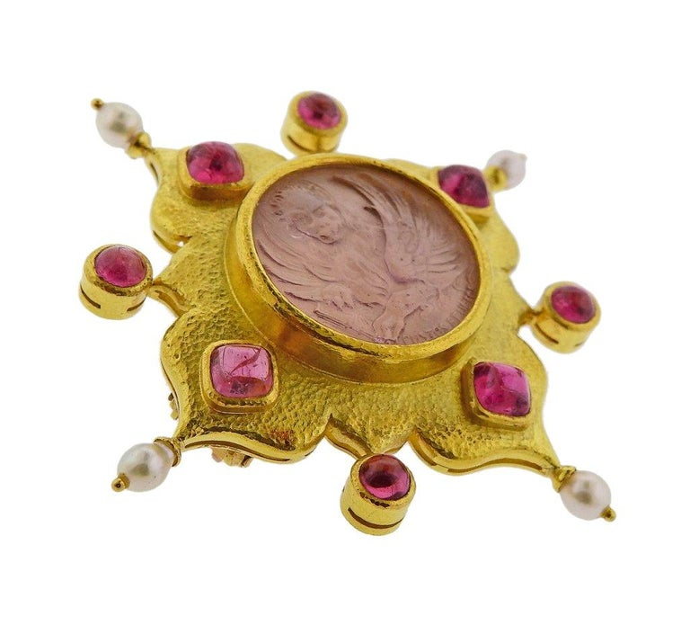 Large 18k gold brooch , designed by Elizabeth Locke, featuring pink Venetian glass intaglio in the center, backed with mother of pearl, surrounded with pearls and pink tourmalines. Brooch - 67mm x 67mm. Marked 18k, E Locke mark.  Weight is 32.5