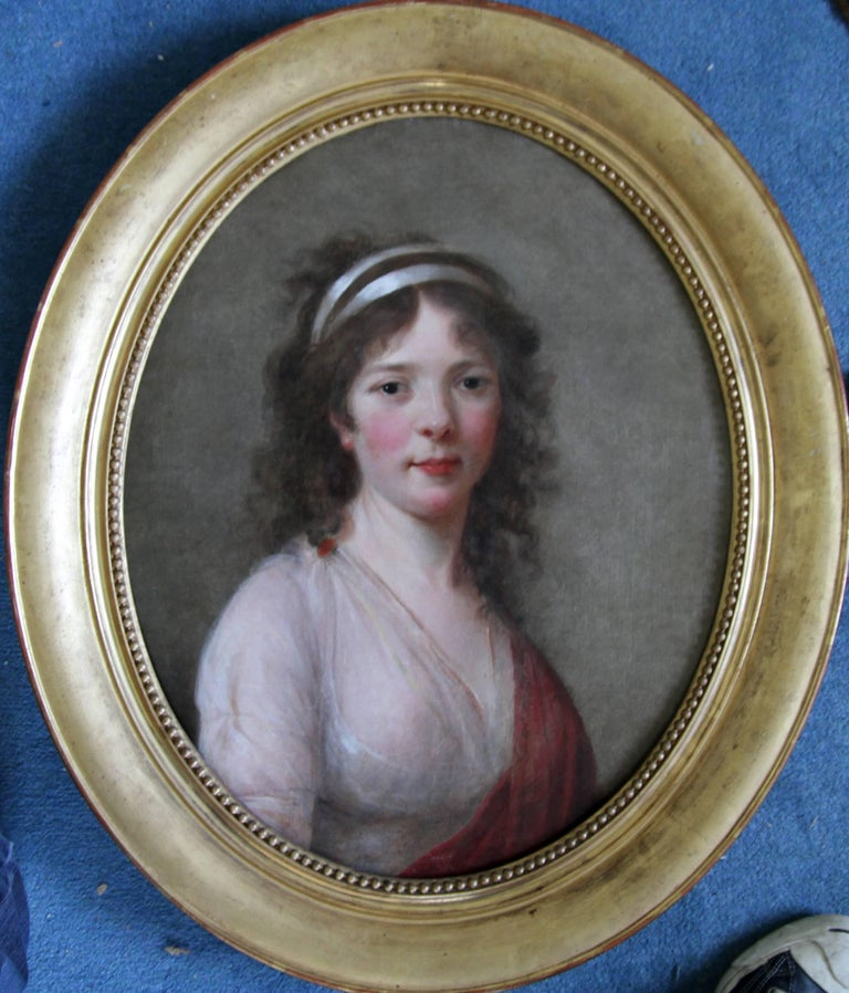 A fine French Old Master oil on canvas which dates to circa 1770 and is attributed to the circle of Elizabeth Vigee Le Brun. A beautiful 18th century portrait in a fine gilded oval frame, it depicts a young woman. A very interesting Old Master