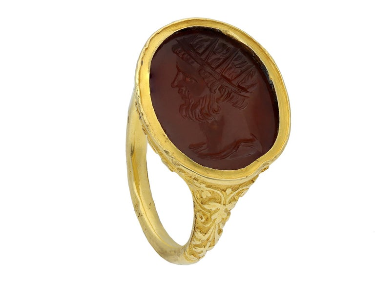 Elizabethan intaglio ring featuring Edward de Vere. An important gold ring set with an oval carnelian intaglio in the Italian style featuring a bearded male in profile, thought to be Edward de Vere, the 17th Earl of Oxford, in the manner of a Roman