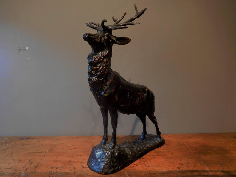 This Sporting Art table sculpture of an Elk is in finely cast zinc alloy which is patinated in bronze with black and burnt-sienna accents. The statue is 16