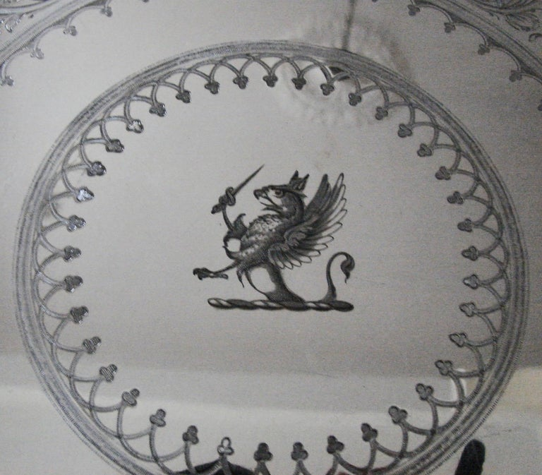 A large and attractive English silver plate tray with a gadrooned edge, the surface with elaborate engine-turned decoration centered by an engraved griffin armorial, resting on three foliate decorated feet. Hallmarked for 1849 made and signed by the