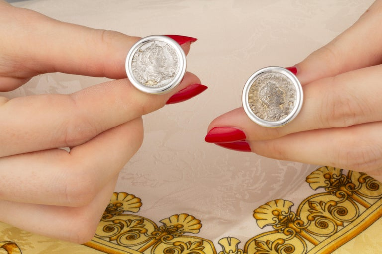 """The antique silver coin cufflinks are elegantly set in white gold. They were hand made in our own workshop in Naples, Italy, according to an original design by Ella Gafter. The cufflinks are signed EG. """"Celebrated for her elegant and meticulously"""