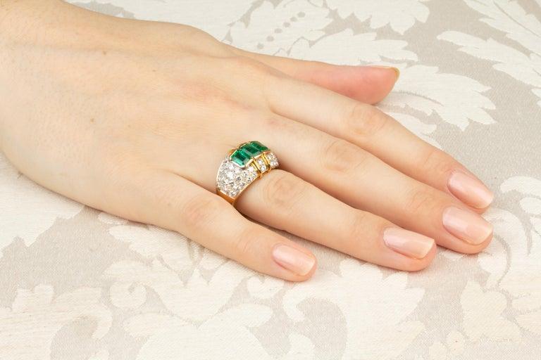 The band features 3 emerald cut Zambian emeralds of brilliant color (1.90 carats) and a pavé of round diamonds (2.22 carats). Our diamonds are of top quality (color, clarity and cut, F/G-VVS). The ring was entirely hand made in 18 carat gold by the