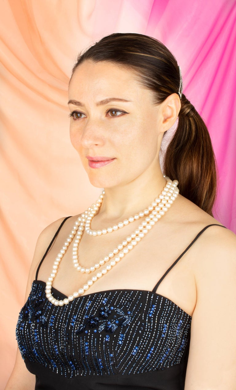 """The 66"""" Japanese Akoya pearl necklace consists of 189 round pearls (Pinctada Fucata) of 8.5/9mm diameter. The pearls display a lovely nacre, lustre, and iridescence. The necklace is held together by a handmade 18 carat white gold clasp decorated"""