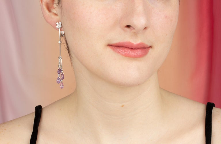 These multicolor sapphire and diamond drop earrings feature 8 briolette sapphires of different colors for a total of approximately 11 carats in a playful and flexible design. The earring is complete with 0.30 carats of round diamonds of top quality