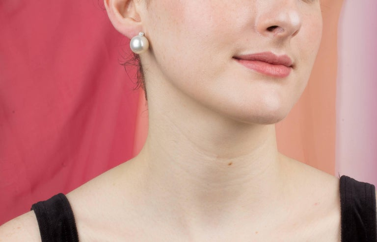The South Sea pearl stud earrings feature two 14/14.5mm diameter pearls from the waters of Northwestern Australia. The design is complete with 4 diamonds (0.26 carats). All of our pearls are untreated: their natural color and high luster have not
