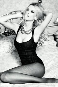 Black & white portrait of supermodel Claudia Schiffer posing in a corset.