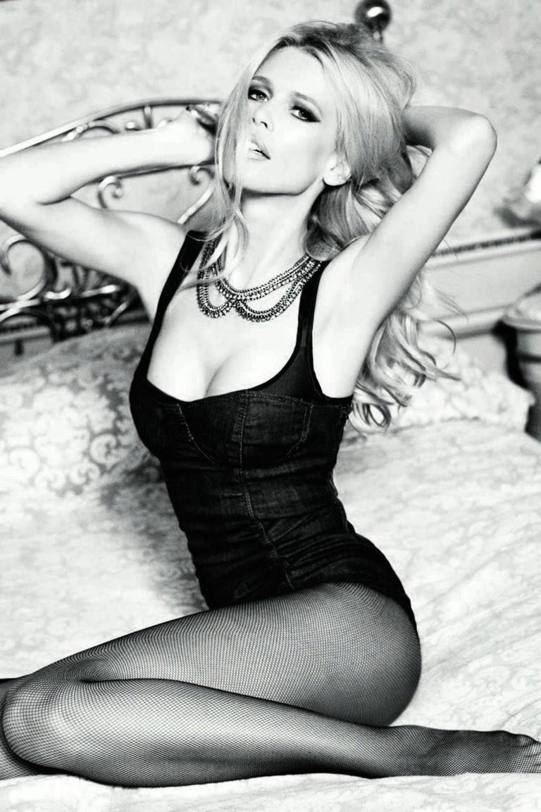 Beautiful black & white portrait of supermodel Claudia Schiffer. She's posing in a jeans corset and grabbing her hair temptingly.   Ellen von Unwerth - the female Helmut Newton - is one of the most famous and influential photographers in the world.