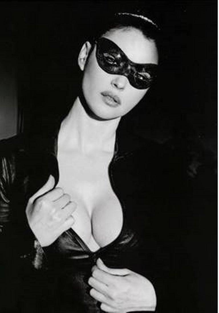 Ellen von Unwerth Black and White Photograph - Monica Belluci with mask, opening her black top