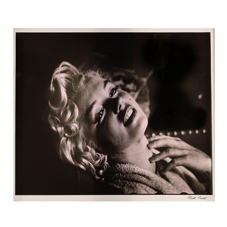 This breathtaking silver-gelatin photograph of Marilyn Monroe in a seductive pose by Elliott Erwitt measures 20 x 24 inches (50.8 x 61 cm) and is an original vintage print developed in 1956. The photograph is personally signed in the lower right by