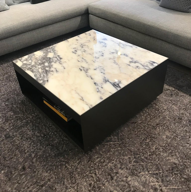 Designed by Rodolfo Dordoni for Minotti, this Elliott coffee table has an Purple Arabescato marble top.