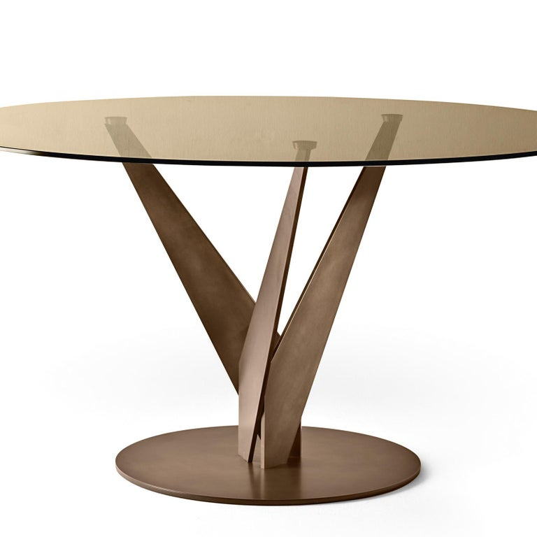 Table ellipse brass and bronzed with tempered bronzed glass top, 10mm thickness. With burnished brass feet. Available in: Diameter 120 x height 75cm, price: 5700,00€. Diameter 140 x height 75cm, price: 5900,00€.
