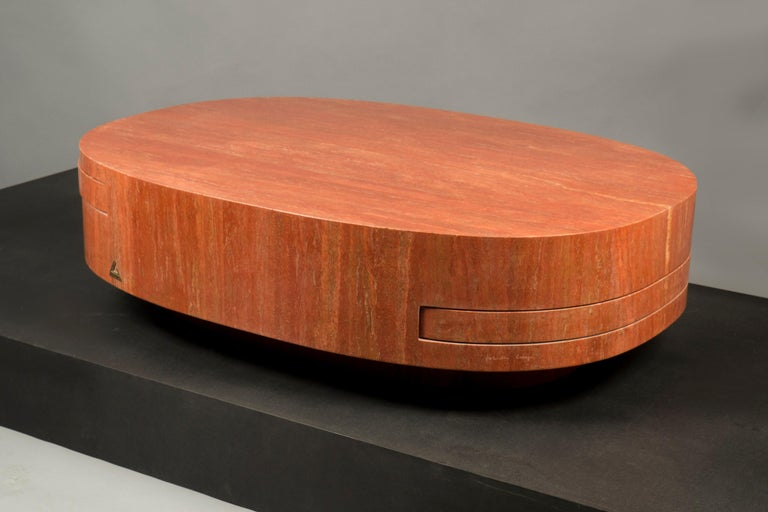 Oval structure with two pull-out shelves, the whole structure clad in Iranian red travertine. This model was created by Crespi in 1976, this table was a special order. Signed, maker's mark and edition T2 on main body. Certificate of Authenticity is