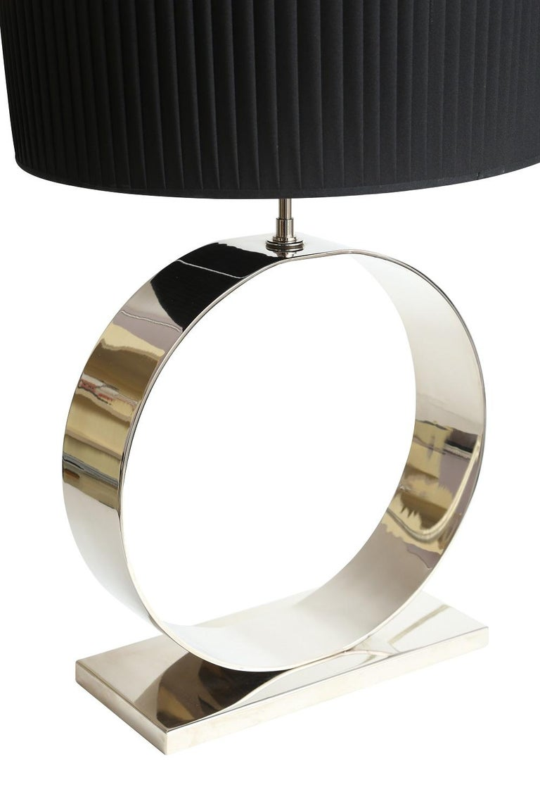 Modern table lamp by Selezioni Domus with a chrome base and black shade.
