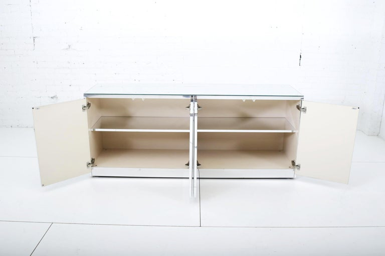 Ella mirrored and chrome credenza. Sides are chrome with chrome detail on front, circa 1970s.