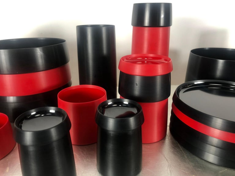 Ellusive Plastik, Skale 34 piece tableware, Torben Orskov, 1953 Denmark. No longer in production,. Stunning set, red and black bakelite, consisting of bowls, cups, plates, containers, lids etc. Ingenious stackable design, Form elegant table setting,