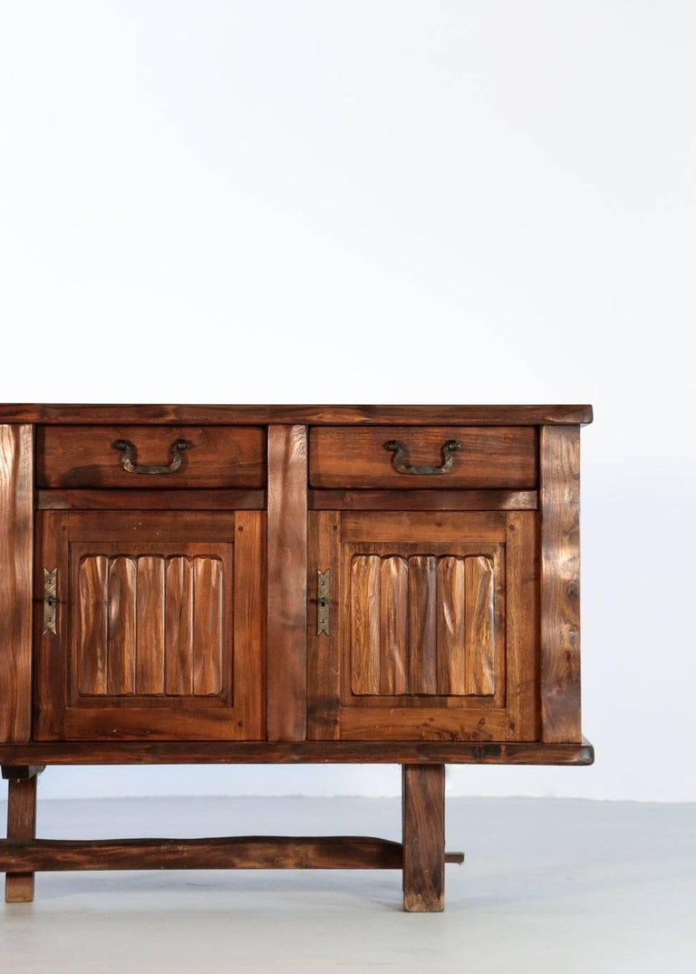 Solid elm sideboard designed by Olavi Hanninen.  Composed of four doors and three drawers. Handles in black metal. Excellent condition.