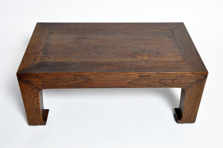 Elm wood coffee table this sturdy coffee table is actually a cut-down Chinese daybed. Elmwood was the preferred furniture wood in Northern China during the 19th century. The large legs (in the Tang horse-hoof style) once supported a much larger top.