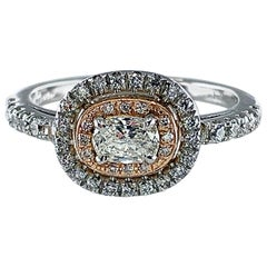 Elongated Cushion Cut Diamond Halo Ring in Platinum and Rose Gold