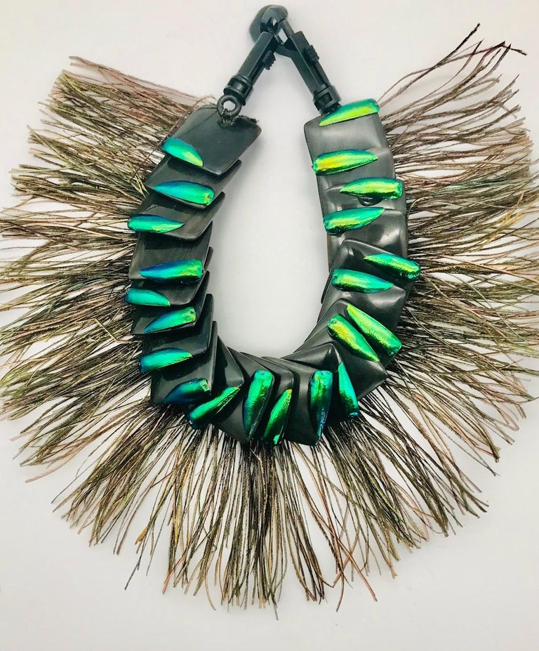 Theatrical ,Statement necklace comprising Elytra Wings on black Resin Squares and Peacock Feathers. This necklace was designed for a theatre in WDC.  Later on it was worn at the Fashion Show in Galle, Sri Lanka, during a Literary and Art Fest, where