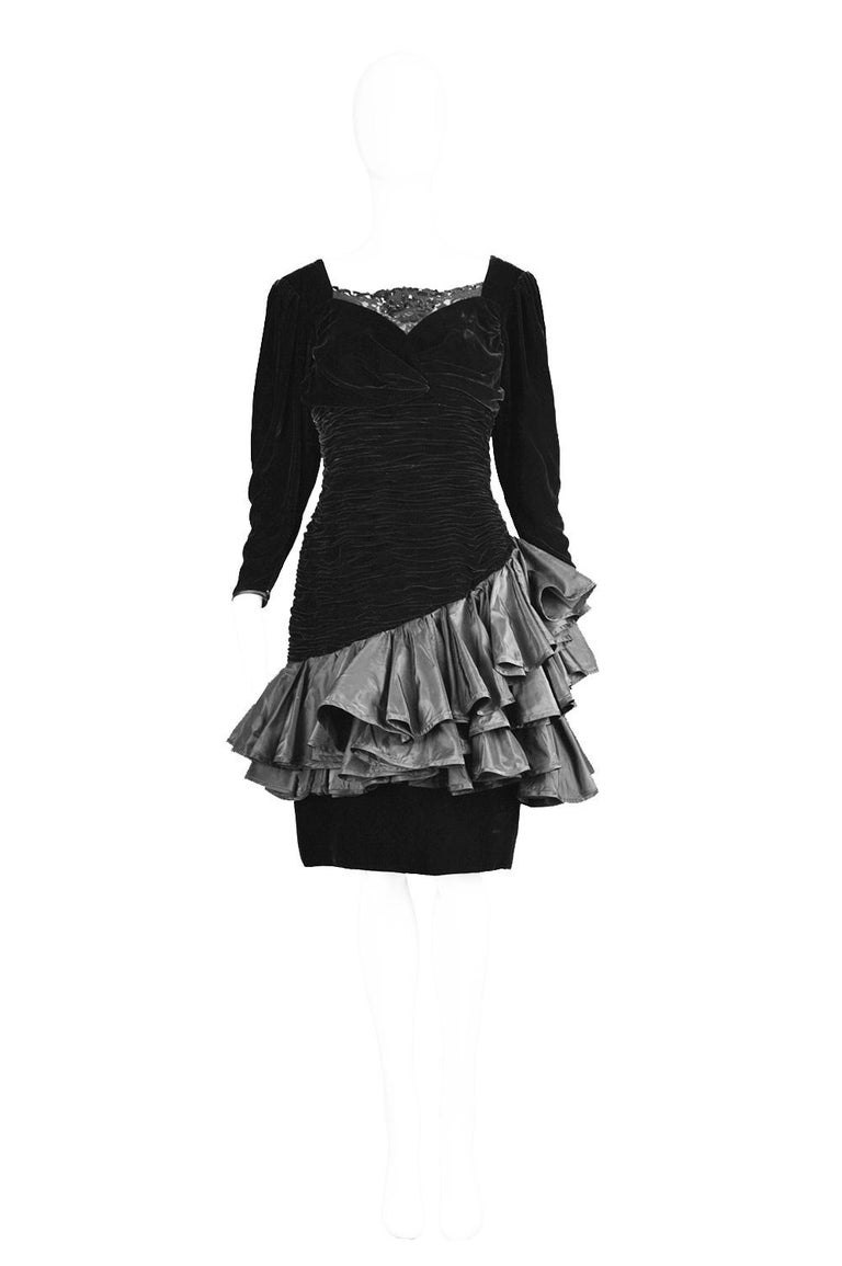 A vintage Emanuel Ungaro formal party dress in a black ruched velvet with pretty black taffeta frilly ruffles and beaded black lace from the 1980s.   Click 'Continue Reading' below to see size & description.   Estimated Size: UK 10/ US 6/ EU 38.