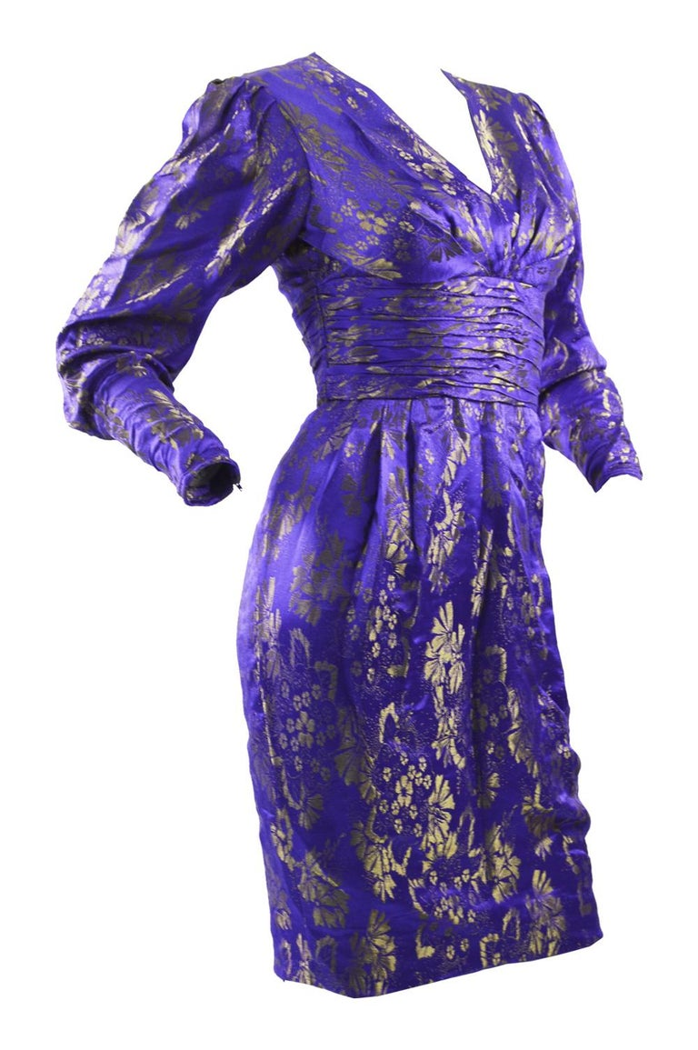 """A fabulous vintage Emanuel Ungaro blue and gold silk brocade party/ evening dress from the 1980s with mutton sleeves and draping at the waist.   Size: Marked UK 6 which is roughly a US 2/ EU 34. Please check measurements.  Bust - 32"""" / 81cm Waist -"""