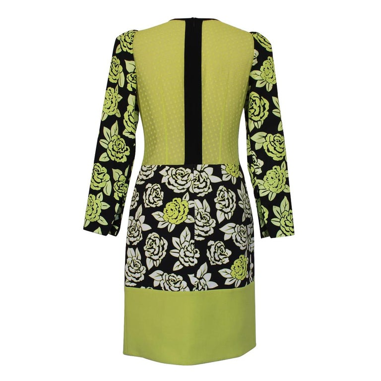 Fantastic Versace dress Rayon (97%) Other fibers Black and fluorescent green color Floral fancy Long sleeves Total length cm 95 (37.4 inches) Shoulder cm 35 (13.7 inches) Worldwide express shipping included in the price !