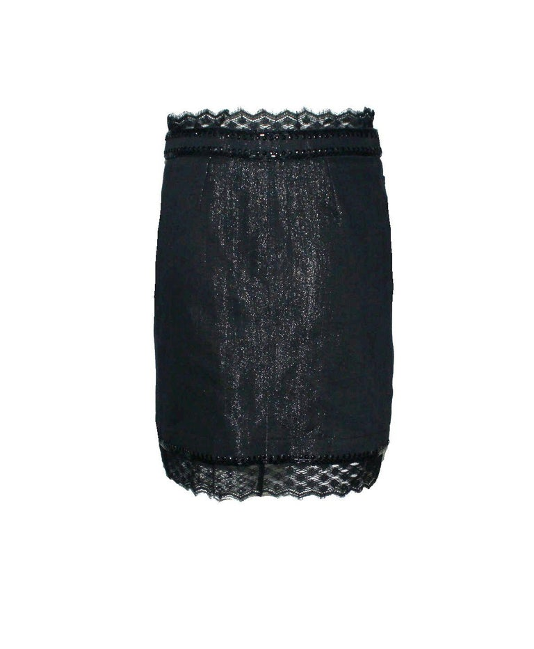 Beautiful denim & lace skirt by CHANEL A true CHANEL signature item that will last you for many years Gunmetal color in a beautiful sparkling denim fabric Skirt opens with a zip and button on front Jet-black embellishement on waist Lace trimming on