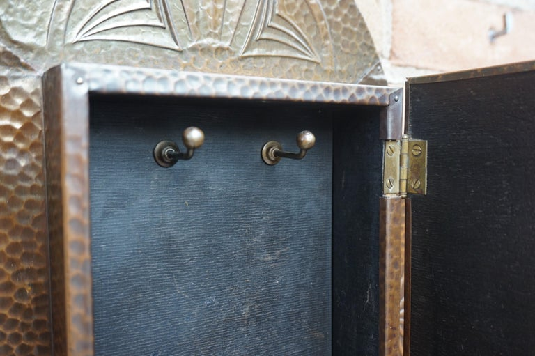 20th Century Embossed and Stunning Arts & Crafts Wall Key Cabinet with Beveled Mirror For Sale