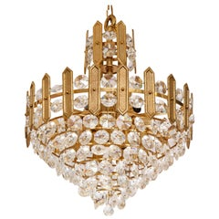 Embossed brass and crystal tiered chandelier by Palwa