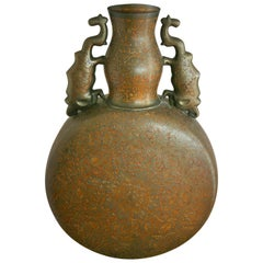 Embossed Brass Urn with Elephant Handles